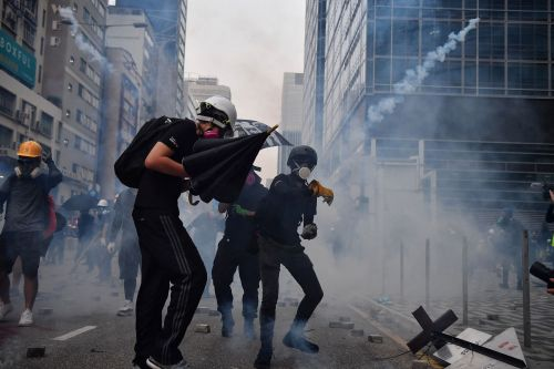 Hong Kong police fire tear gas in clash with protesters