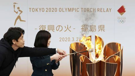 Tokyo 2020 organizers pass Olympic flame to Fukushima after Games postponement