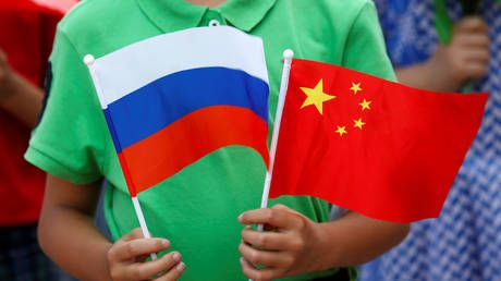 China's FM hails joint effort by Beijing and Moscow to fight 'political virus' and ensure global stability