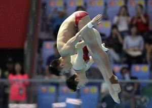 China wins first 3 diving golds at worlds; Bacon gets silver