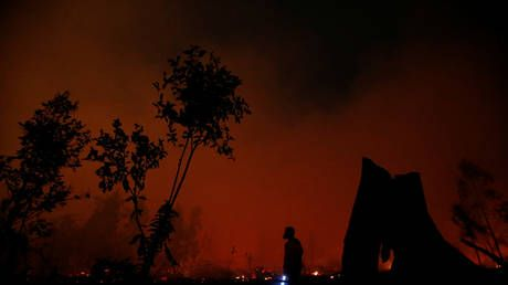 'This is Earth, not Mars': Alarmed locals share photos of blood-red sky in Jambi, Indonesia