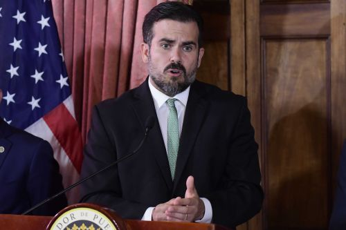 Puerto Rico gov will not seek reelection, leaves his party amid calls for resignation