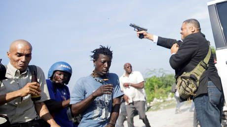 Haitian senator shoots photographer in the FACE amid political chaos in Port-au-Prince