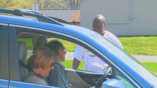 Volunteers from New Day Ministries deliver crucial supplies to elderly, people in need
