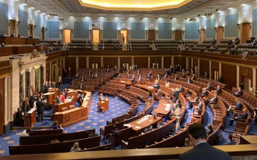 Rare photos show lawmakers sitting in the House's public gallery and using social distancing while voting on $2 trillion coronavirus relief bill