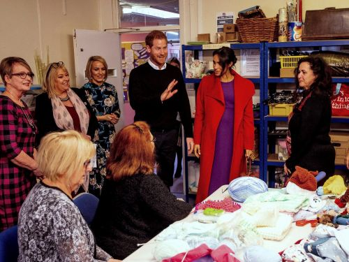 Prince Harry called himself 'a feminist' during a visit to a women's charity, and hugged or shook the hand of everyone there