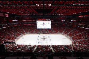 NHL teams aim to fill arenas, drawing fans away from screens