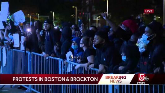 Protesters outside Boston police headquarters chant George Floyd's name