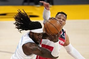 Wizards win 5th straight, hold off Lakers, 127-124, in OT