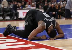 Pistons' Drummond leaves vs. Heat after being hit in face