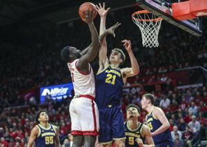 Simpson, Wagner spark Michigan to 60-52 victory over Rutgers