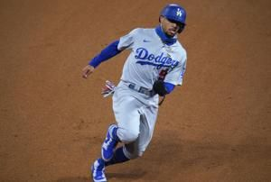 Dodgers use big 7th inning to beat Rockies 9-3
