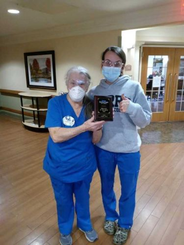 This 81-year-old nursing assistant was recognized for perfect attendance during 2020
