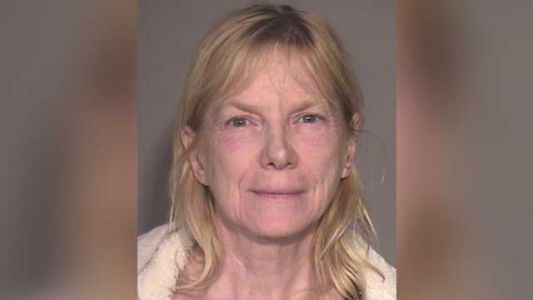 Woman arrested after 96-year-old father found living in home with hundreds of rats