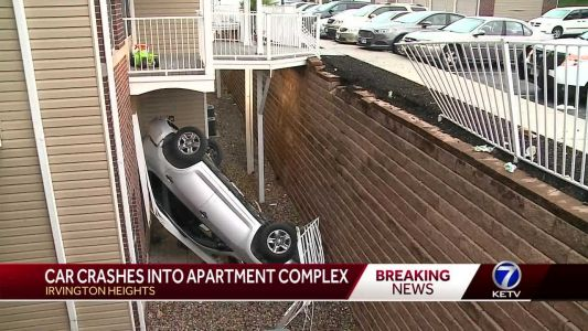No injuries after car drives off retaining wall