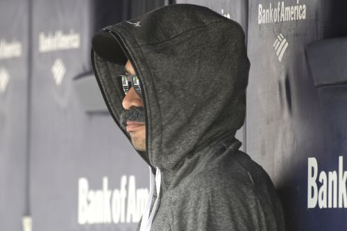 Ichiro sits in dugout with Bobby V-like fake mustache disguise