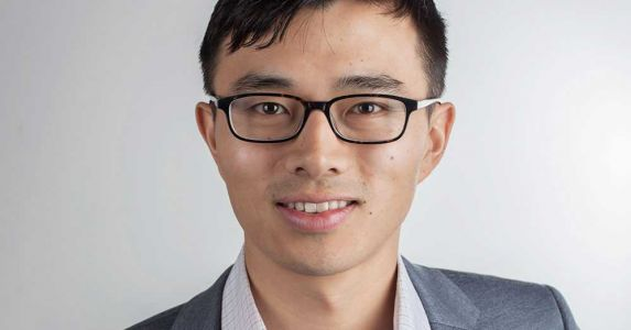 Immigrant from China Builds Business in Seattle to Aid Other Immigrants with Naturalization