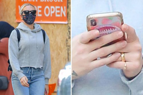 Scarlett Johansson flashes wedding ring in New York after marrying Colin Jost