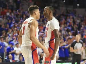 Lewis helps No. 15 Florida to tight win over Towson