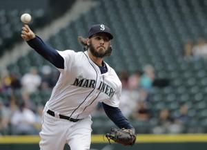 Colon deals 7 2/3 scoreless for win in Seattle