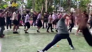 Thai protesters mock government with hamster song and rubber chickens