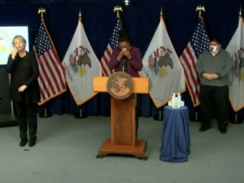 The public health director for Illinois broke down in tears while announcing a new state record for COVID-19 infections
