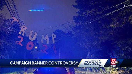 Trump banner hung over busy roadway