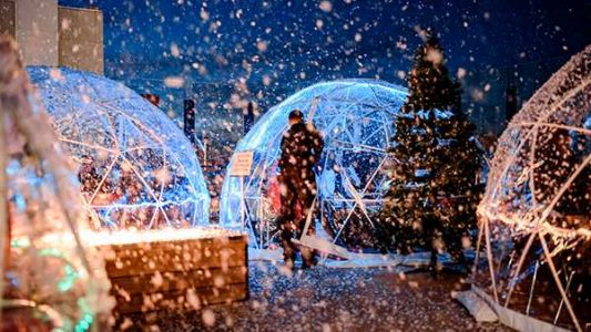 Popular Louisville bar decks out rooftop with snow machines, heated igloos