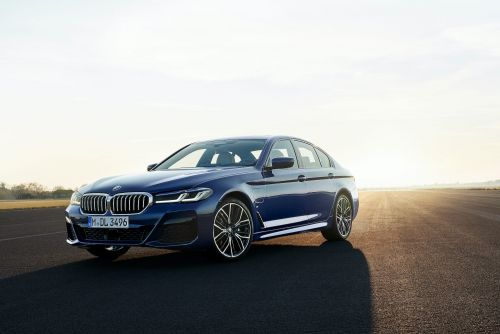 BMW updated its 5 Series sedan with a new look and a mild hybrid system that'll shut off the car off while cruising to save gas