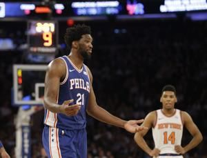 Sixers' Embiid out at least week with sore knee