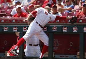 Reds put Votto on IL with back strain, recall O'Grady