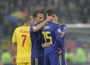 UEFA charges Romania with 'racist behavior'