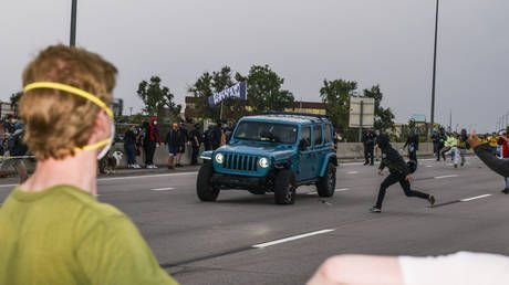 Protester shoots another protester while trying to hit car speeding through crowd on Aurora, Colorado highway