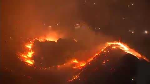 Fast-moving wildfire sweeps into northern Los Angeles; 23,000 households told to evacuate