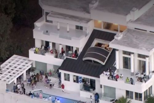 Video shows police responding to large party at Los Angeles mansion
