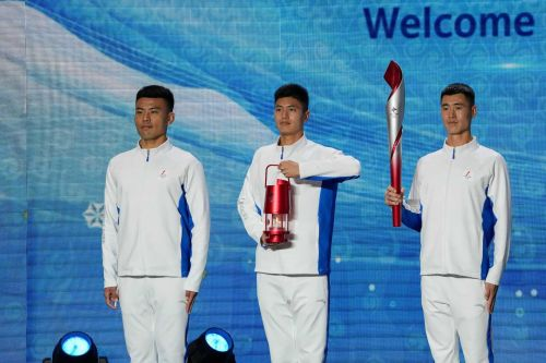 Olympic flame arrives in Beijing amid calls to boycott the Winter Games