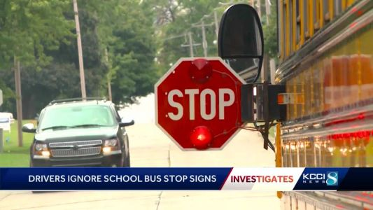Experts say law makes it difficult to convict those passing stopped school buses