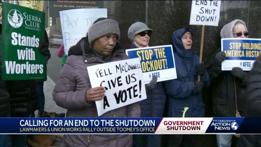 Rally outside Sen. Pat Toomey's office in downtown Pittsburgh demands an end to the government shutdown