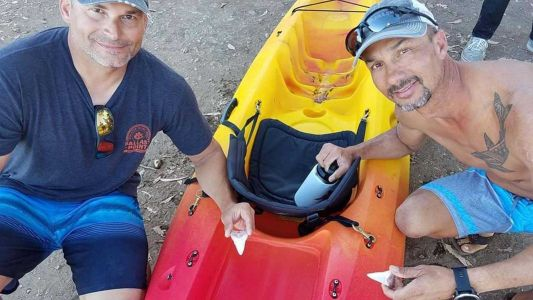 An 'enormous' great white shark sank its teeth into a man's kayak