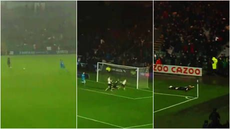 'Goal of the century': Footballer celebrates by swimming on the pitch as fans go wild for bizarre strike in freak downpour