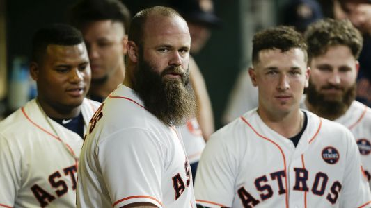 Former Astros slugger Evan Gattis explains purchase of 'snitches get stitches' glass featuring Mike Fiers