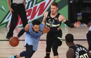 Grizzlies roll past Bucks 119-106, reach West play-in round