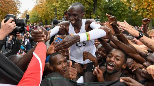 'No human is limited': Man makes history, runs marathon in under 2 hours
