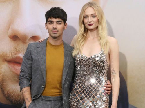 Sophie Turner stole the show at Joe Jonas' 30th birthday party in a black dress with a plunging neckline and thigh-high slit