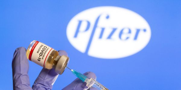 Pfizer climbs after boosting its 2021 COVID-19 vaccine sales forecast by 73%