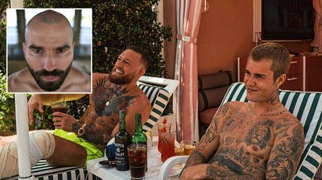 UFC's McGregor sups whiskey with pop star Bieber in the sun as he backs Russian training partner Artem Lobov in bare-knuckle bout