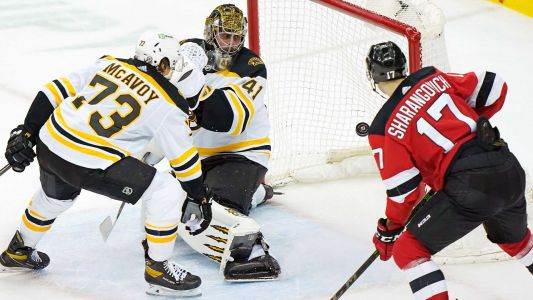 Bruins fall to Devils in OT one night after clinching playoff spot