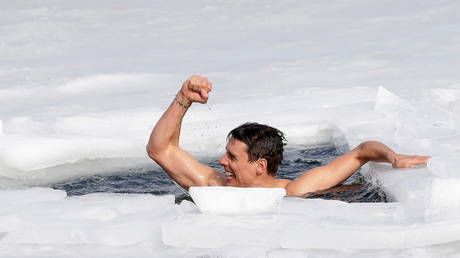 81m in one breath: Daredevil Czech free-diver sets new world record by holding out to swim under thick ice in frozen lake
