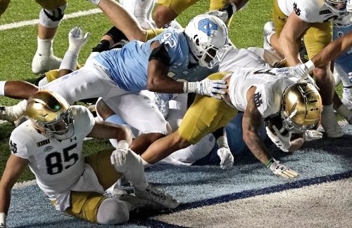 QB Ian Book and Notre Dame's defense help the Irish remain undefeated with a 31-17 victory over North Carolina
