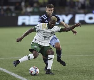 Dajome converts penalty, Whitecaps rally to beat Timbers 3-2